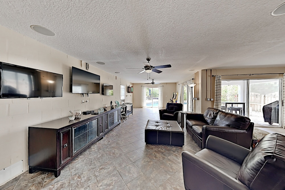 Living Room, Immaculate Canal W/ Pool, Dock & Game Lounge 4 Bedroom Home