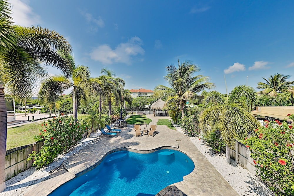 Featured Image, Immaculate Canal W/ Pool, Dock & Game Lounge 4 Bedroom Home