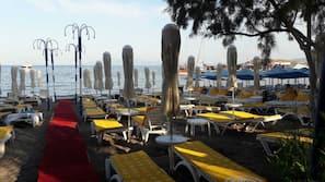 Private beach, black sand, free beach cabanas, sun-loungers
