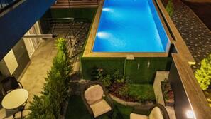 Seasonal outdoor pool, open 7:00 AM to 7:00 PM, pool umbrellas