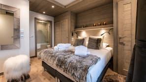 4 chambres, coffre-forts dans les chambres, fer et planche à repasser