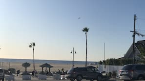 On the beach, white sand, beach towels, 6 beach bars