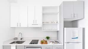Full-size fridge, stovetop, dishwasher, coffee/tea maker