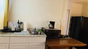 Fridge, microwave, hob, coffee/tea maker