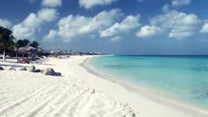 On the beach, white sand, free beach shuttle, beach towels