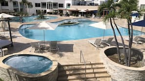 3 outdoor pools, open 9:00 AM to 9:00 PM, free cabanas, pool umbrellas