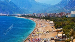 On the beach, free beach cabanas, beach shuttle, 20 beach bars
