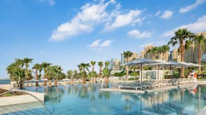 4 outdoor pools, cabanas (surcharge), pool umbrellas