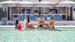 Outdoor pool, open 8:00 AM to 8:00 PM, pool loungers, lifeguards on site