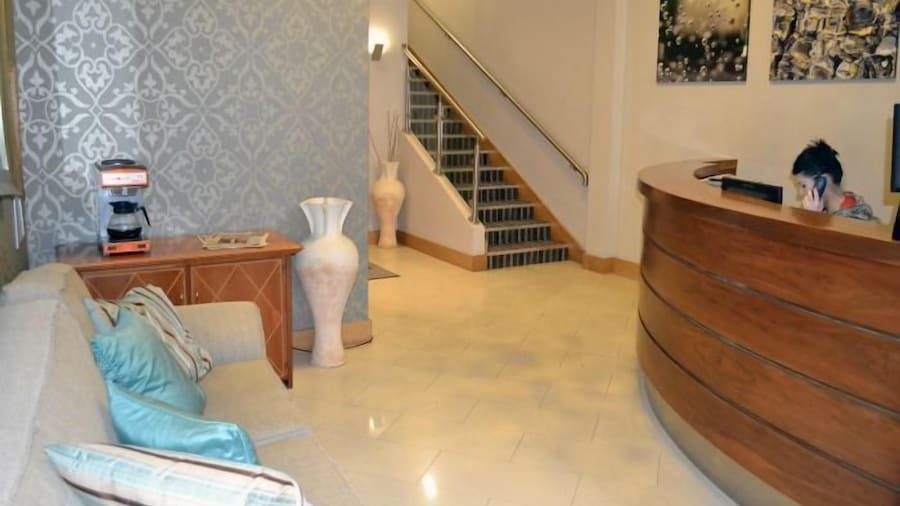 Carrick Plaza Suites & Apartments