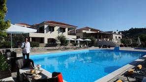 Seasonal outdoor pool, open 11:00 AM to 7:30 PM, pool umbrellas