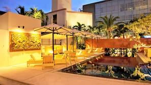 Seasonal outdoor pool, open 10:00 AM to 8:00 PM, free pool cabanas