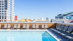 Outdoor pool, free pool cabanas, pool umbrellas