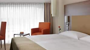 Hypo-allergenic bedding, down comforters, minibar, in-room safe