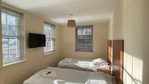 Egyptian cotton sheets, premium bedding, laptop workspace, soundproofing
