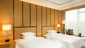 1 dormitorio, edredones de plumas, colchones con acolchado adicional