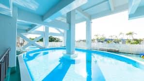 Seasonal outdoor pool, open 9 AM to 6:30 PM, pool umbrellas
