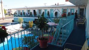 Seasonal outdoor pool, open 10:30 AM to 8 PM, pool umbrellas