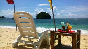 On the beach, free beach shuttle, free beach cabanas, sun loungers