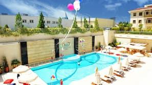 2 indoor pools, seasonal outdoor pool, pool umbrellas, pool loungers