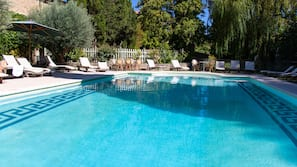Outdoor pool, open 10:00 AM to 8 PM, pool loungers
