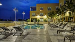 Outdoor pool, open 6:00 AM to 10:00 PM, pool umbrellas, sun loungers