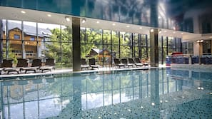 Indoor pool, open 7 AM to 11 PM, pool loungers