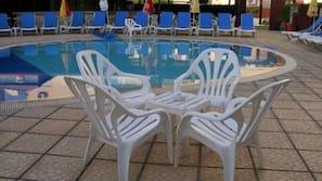 Seasonal outdoor pool, open 9 AM to 7 PM, sun loungers