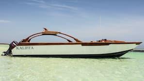 Private beach nearby, white sand, free beach shuttle, beach umbrellas