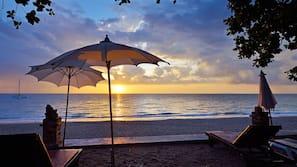 On the beach, beach umbrellas, beach towels, beach bar