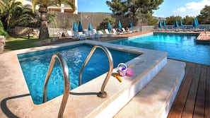2 outdoor pools, open 10:00 AM to 7:00 PM, pool umbrellas, pool loungers