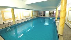 Indoor pool, outdoor pool, open 10:00 AM to 6:00 PM, pool umbrellas