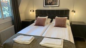 Premium bedding, pillowtop beds, minibar, individually decorated