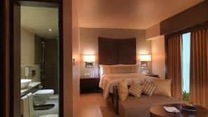 Hypo-allergenic bedding, down duvet, in-room safe, rollaway beds