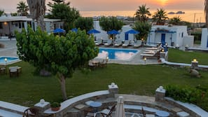 Outdoor pool, open 9 AM to 8:30 PM, pool umbrellas, sun loungers