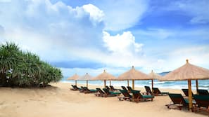 White sand, sun-loungers, beach umbrellas, beach towels