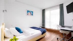 Hypo-allergenic bedding, desk, laptop workspace, blackout curtains