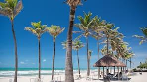 On the beach, sun-loungers, beach towels, beach volleyball