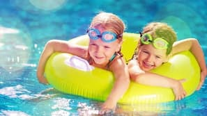 Seasonal outdoor pool, open 9:00 AM to 9:00 PM, sun loungers