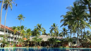 Outdoor pool, a waterfall pool, pool umbrellas, sun loungers
