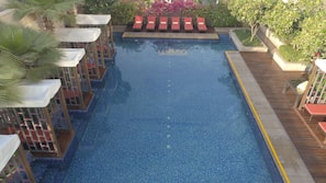 Outdoor pool, open 7:00 AM to 8:00 PM, pool loungers