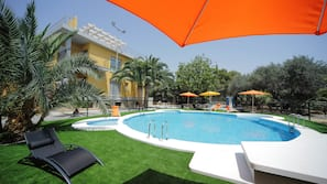 Outdoor pool, open 10 AM to 10 PM, pool umbrellas, pool loungers