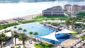 2 outdoor pools, open 7:00 AM to 8:00 PM, free cabanas, pool umbrellas