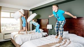 Premium bedding, blackout curtains, iron/ironing board