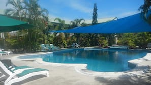 Outdoor pool, open 7 AM to 9 PM, pool umbrellas, sun loungers