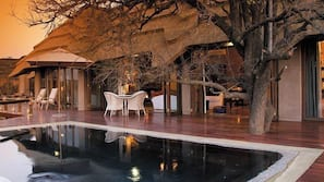 12 outdoor pools, pool umbrellas, pool loungers