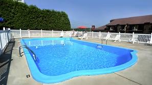 Seasonal outdoor pool, open 9 AM to 9 PM, pool umbrellas
