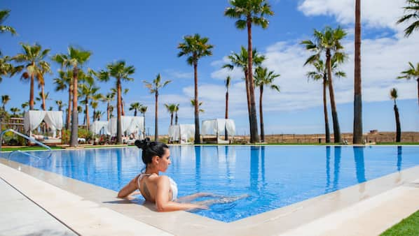 2 outdoor pools, open 10:00 AM to 6:00 PM, pool umbrellas, sun loungers