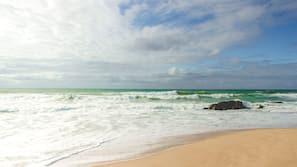 Beach nearby, white sand, surfing