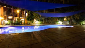 Outdoor pool, open 7 AM to 6 PM, pool loungers